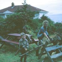 8. 1966 Betty sawing wood SMALL.jpg
